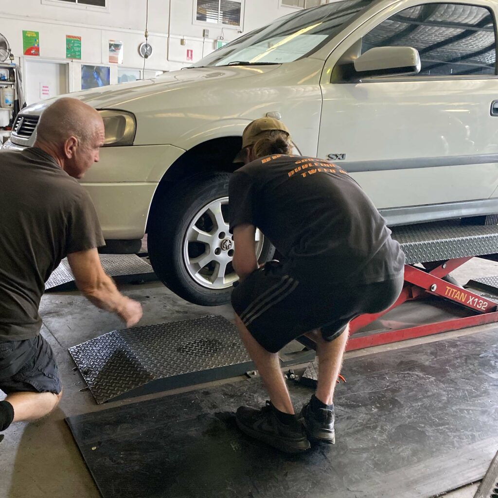 Chris Lett assisting a tyre replacement at the Branigans Burleigh Heads branch in the Gold Coast.