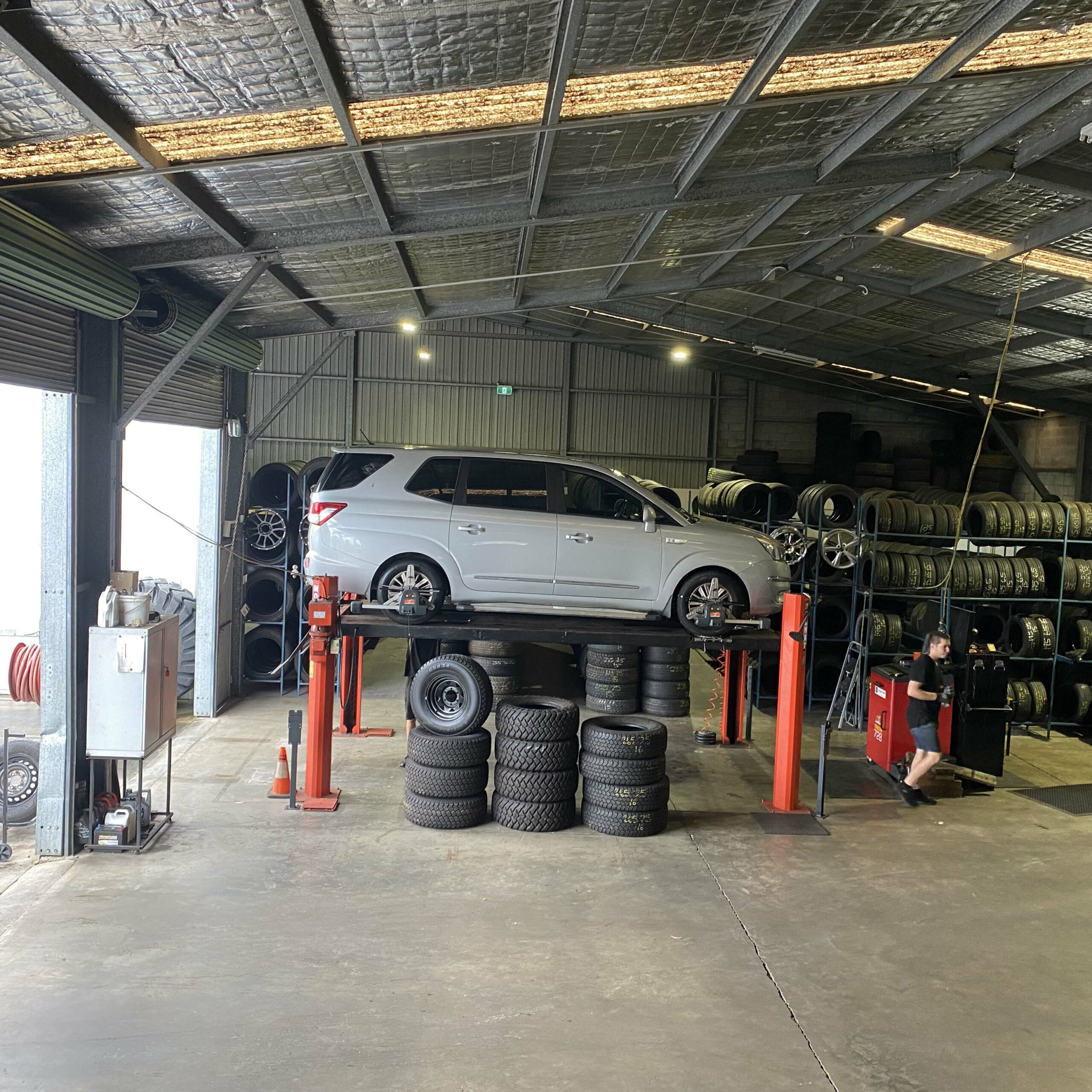 Car on jack at the Branigans Burleigh Heads tyre shop.