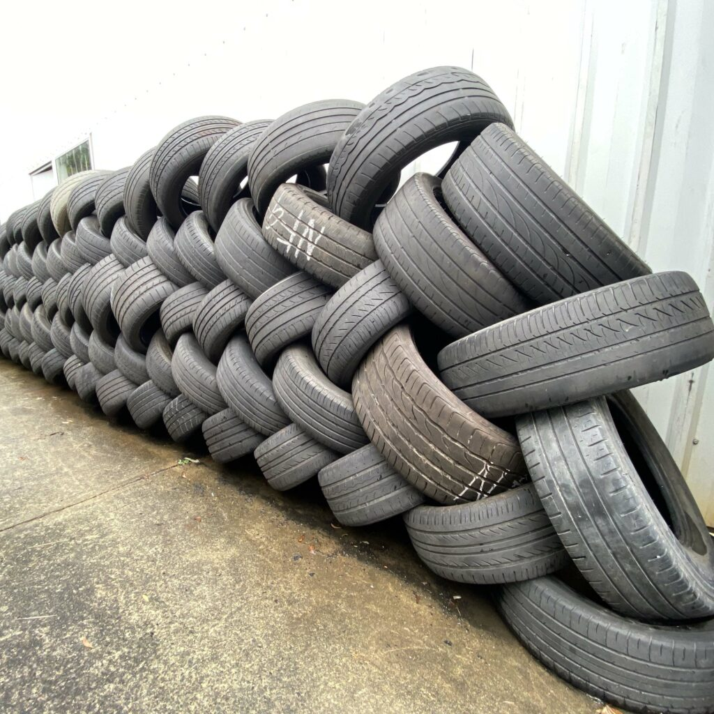 Tyres stacked up against the wall of the Branigans Burleigh Heads tyre shop in the Gold Coast