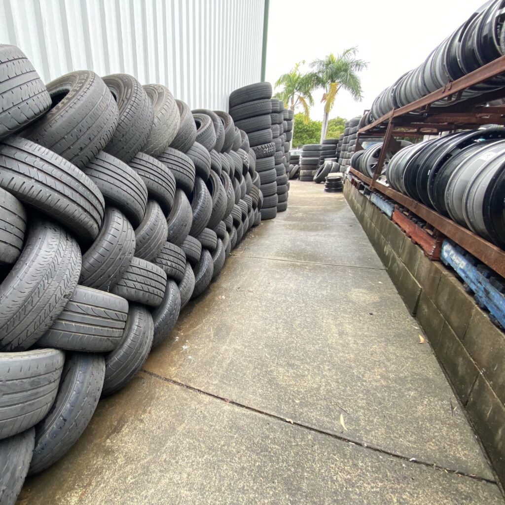 Tyres stacked against the wall outside Branigans Tyres in the Gold Coast.