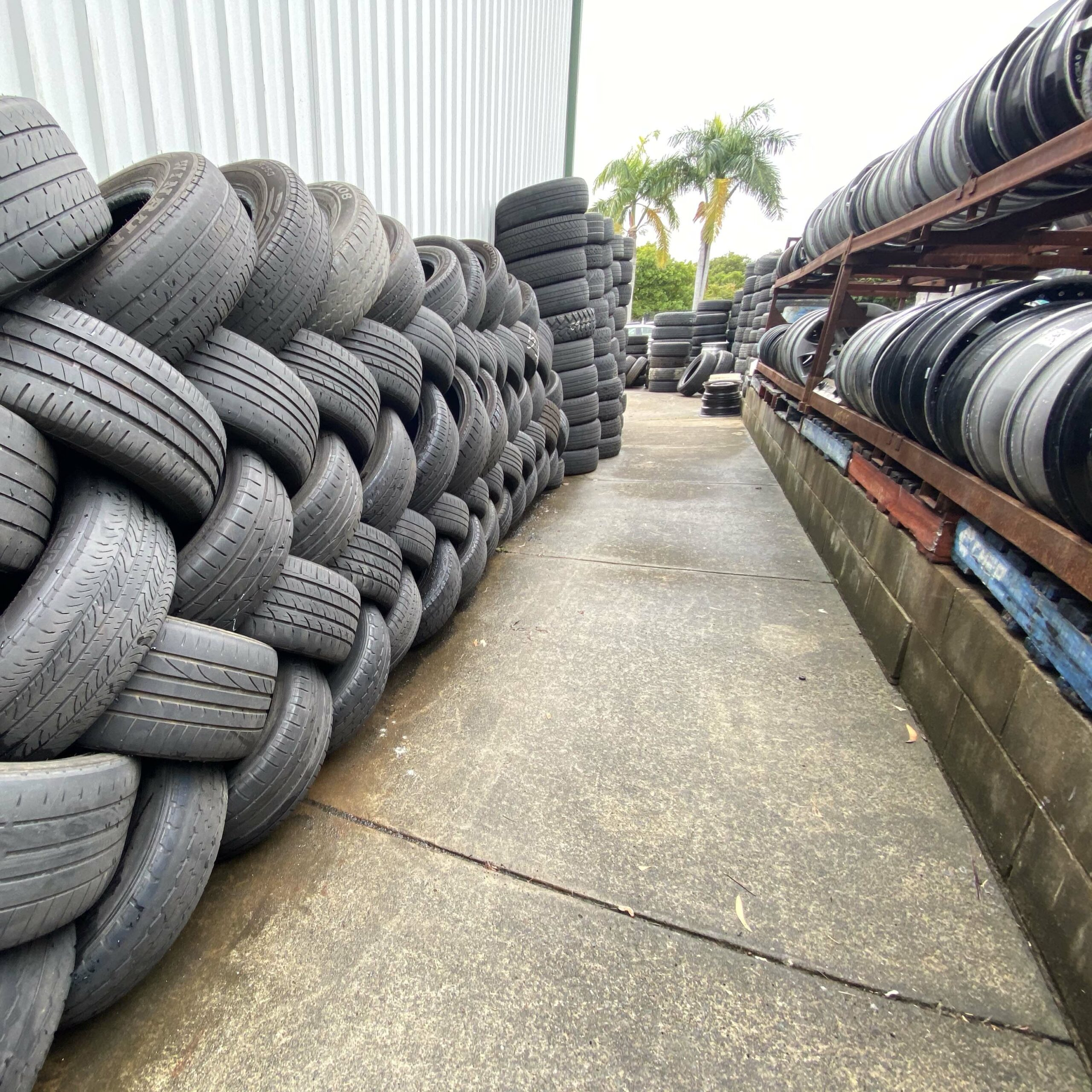 Rows of tyres stacked up outside the Branigans Burleigh Heads tyre shop in the Gold Coast.