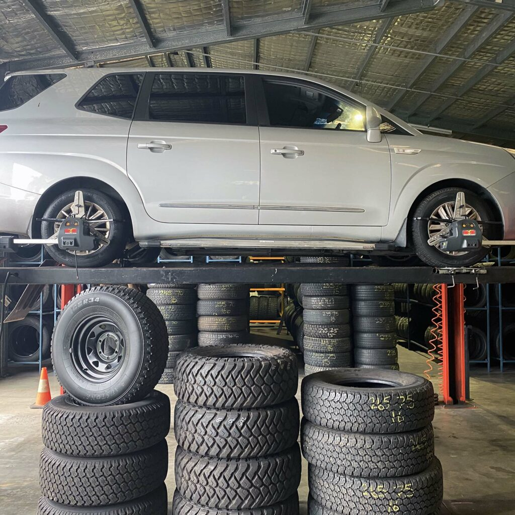 Wheel alignment being done on a car at the Branigans Burleigh Heads tyre shop in the Gold Coast.