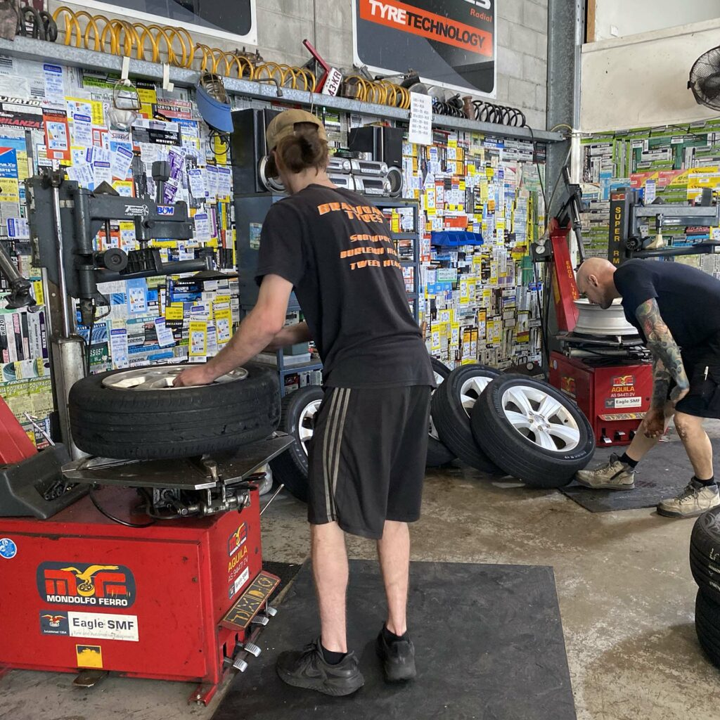 Staff at the Branigans Burleigh Heads branch in Gold Coast replacing a tyre.