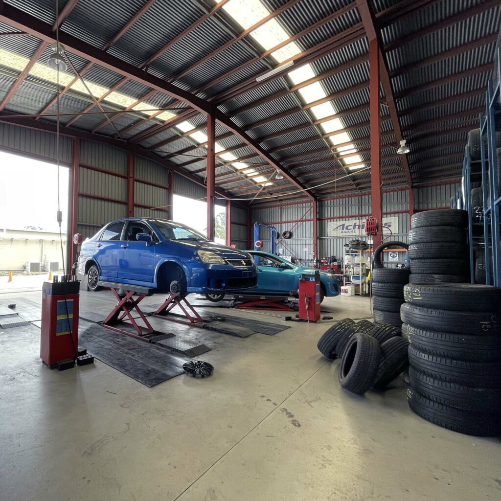 Car being fitted with replacement tyres at Branigans Tyres in the Gold Coast.