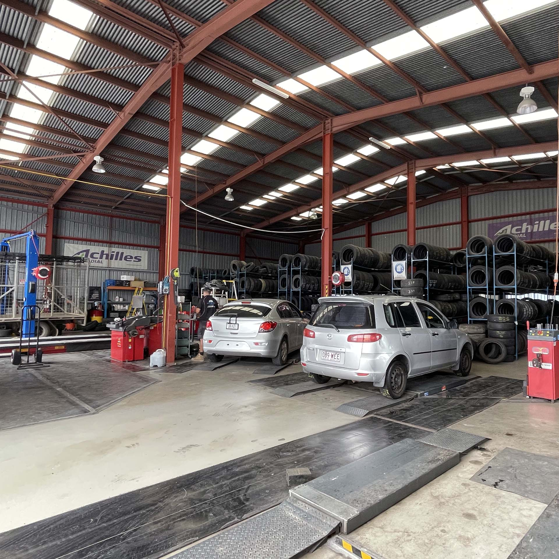 Cars waiting for replacement tyre at the Branigans Southport tyre shop in the Gold Coast.
