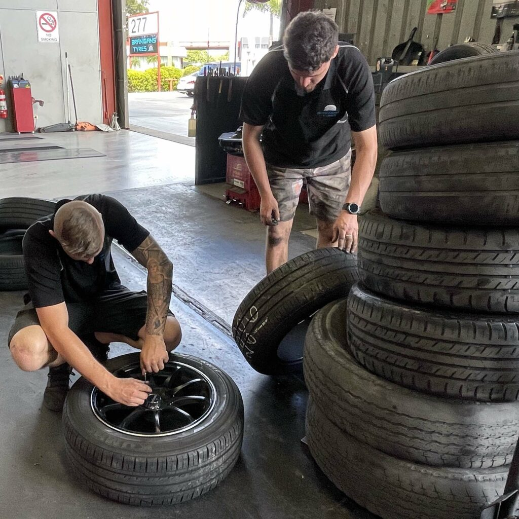 Putting on new tyres at the Branigans Southport tyre shop in the Gold Coast.