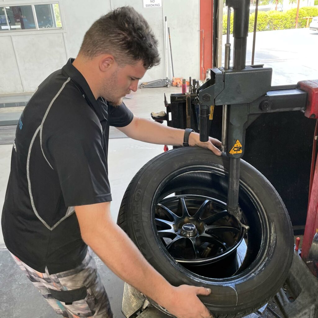 Staff removing tyre at the Branigans Southport tyre shop in the Gold Coast.