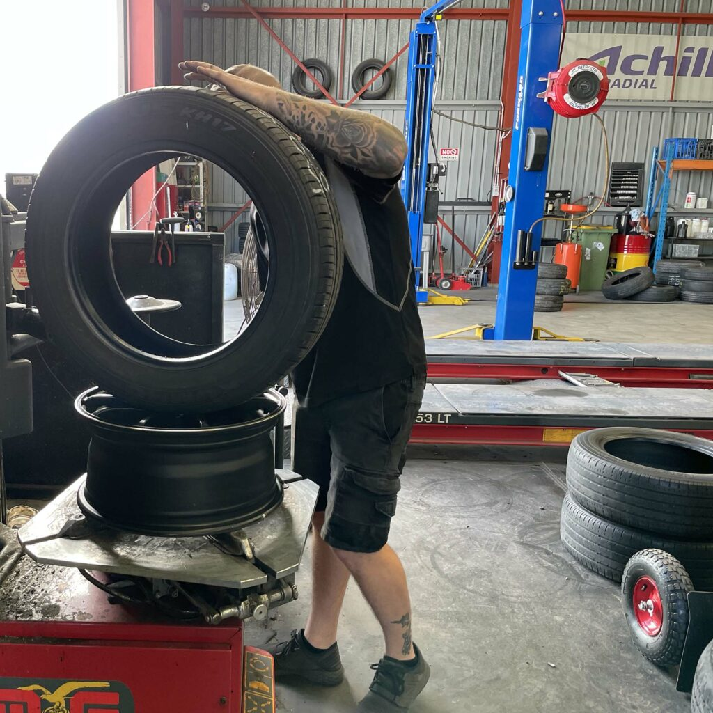 Staff member inspecting tyre at the Branigans Southport branch.