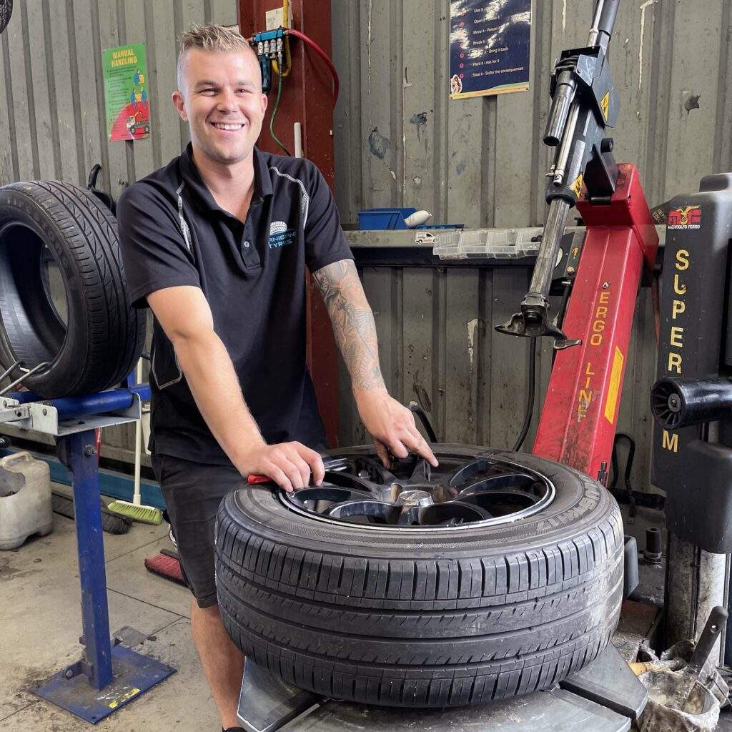 Staff member at the Branigans Southport tyre shop in the Gold Coast.