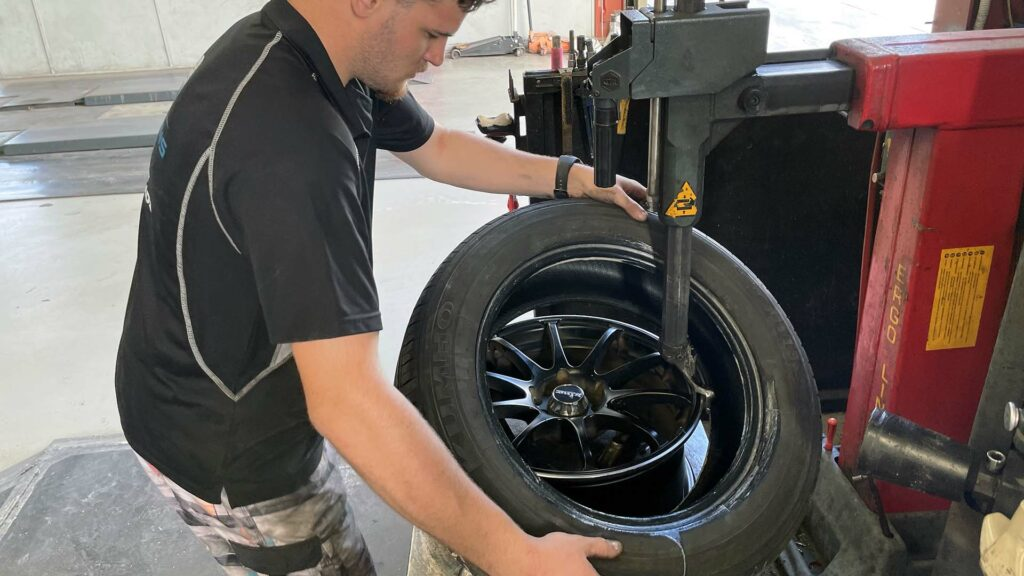 Removing tyre at Branigans Tyres in the Gold Coast.