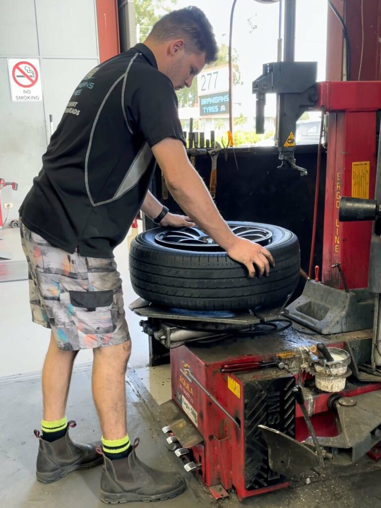 Fitting a new tyre at the Branigans Southport tyre shop in the Gold Coast.